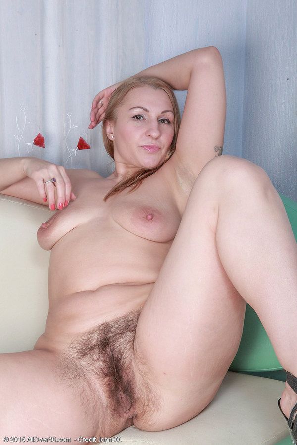 Fingering her hairy gash