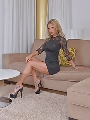 Dirty blonde in sexy lingerie and heels fingers her hot pussy
