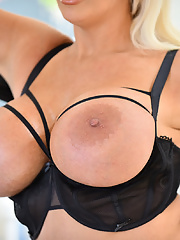 Dressed in black lingerie beauty with juicy big tits Alura Jenson
