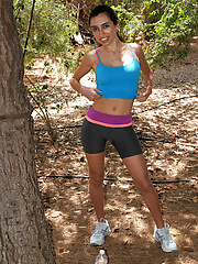 Exotic hottie Bella G jogs and strips in the woods