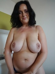 Fatty granny wife undressing her white pants in close up