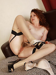 Fiona from AllOver30 spreads her hairy pussy for you