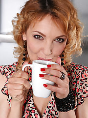Gina Monelli shows off her cookie while having a coffee