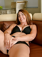 Gorgeous Carissa Dumonde unwraps lingerie to expose her mature ass