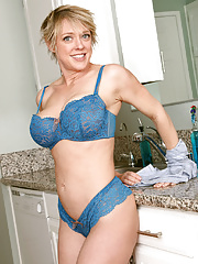 Gorgeous mature wife Dee Williams slips out of her jeans skirt to pose for us in kitchen