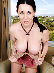 Gorgeous Rayveness shows off her big her mature boobs for nude posing in sexy lingerie