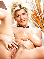 Gorgeous wife GILF slowly strips to show hairy twat close up