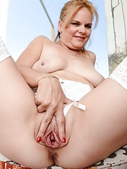 Granny in white stockings getting wild and spreads her asshole