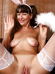 Granny Ivana Slew in bunny costume sticks a butt plug into her ass