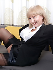 Granny Lorna Blu in leather skirt and black stockings displays her nice racks