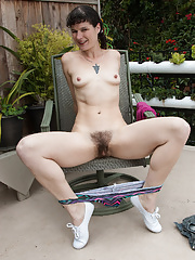 Hairy MILF Amber S taking off her shorts to show natural hairy pussy outdoors