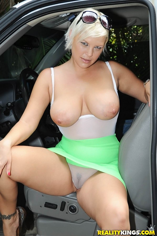 Sexy milf getting out of car
