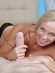 Horny blonde mature Dani rubbing throbbing cockhead