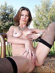 Horny brunette Jizzabelle posing in lingerie at the park