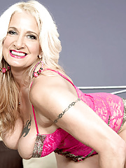 Horny GILF with pierced nipples and tattooed body in pink lingerie