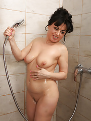 Horny housewife Nataly strips and showers