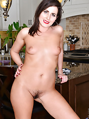 Horny housewife strips down and gets naughty in the kitchen