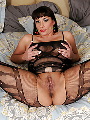 Horny Sabotage looking hot in her lacy crotchless bodysock