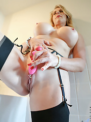 Hot Blonde cougar reveals her huge tits and sexy curves nad pierced clit