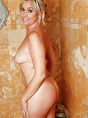 Hot blonde mom with a big juicy ass soaps herself up in the shower