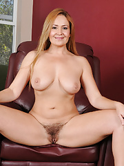 Hot cougar Elexis Monroe unzips her dress to expose her hairy twat