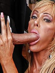 Hot GILF in slutty fishnet sucking her boyfriends boner and get screwed in the kitchen