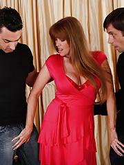 Hot horny mom Darla Crane with big fake tits fucking two cocks