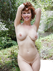 Hot mature redhead play with her natural tits