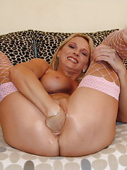 Hot MILF fisting and toy fucking herself