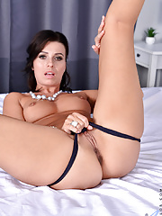 Hot milf with small boobies spreading legs to show her pink pussy