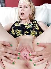 Hot short haired granny with saggy tits taking off her dress and panties