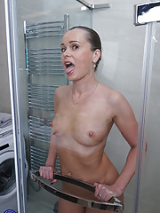 Housewife taking a hot shower and inserting sex toy into her ass