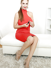 Huge boobed Carol Goldnerova removes her red dress and displays hungry twat