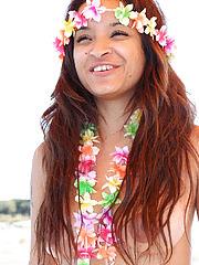 Island girl Vera Waang slips off her coconuts while sailing