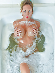 Janelle is a blonde milf with big tits bathing