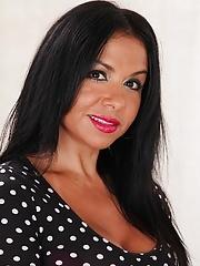 Latin MILF Marisa Mendes exposes her big tan lined breasts
