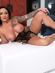 Mature Ashton Blake with big pierced tits and high heels showcases her long legs