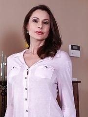 Mature brunette Nora Noir slips out of her blue jeans