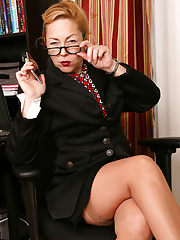 Mature business Goddess Justine stripping off her lingerie and getting naked at work