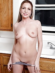 Mature Jessica Taylor expose bald cunt in kitchen