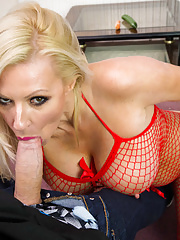 Mature lady Michelle Thorne gets load of cum on her fake big boobs