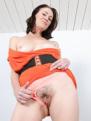 Mature lady stripping and showing off nice pussy
