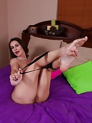 Mature Nora Noir slips out of her dress and shows off her sexy body