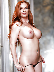 Mature redheaded Diamond Foxxx exposing large tits and booty in yoga pants
