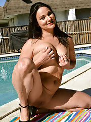 Mature Roxy Reed showcasing her curvy body and shaved twat by the pool