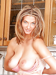 Mature sexy babe takes off clothes to pose naked in kitchen