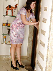 Mature teasing a guy with her upskirt look getting packed in the kitchen