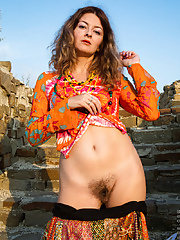 Mature with hairy pussy & small tits outside