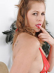 Melissa Rose in red lingerie tugging on her furry pussy