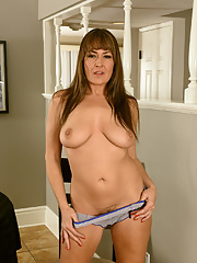 Middle aged sexy mature Elexis Monroe kneads her big saggy tits